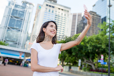 young woman taking photo in hong