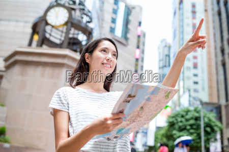 young woman use of city map