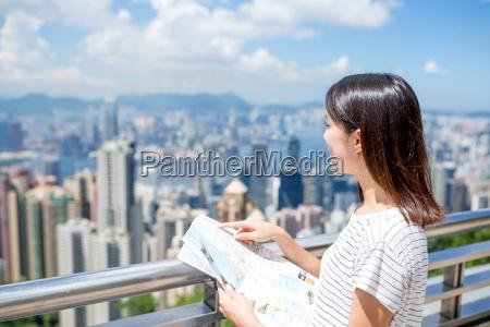 young woman travel in hong kong