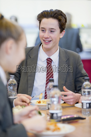 high school student eating lunch in