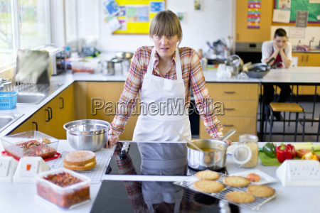 portrait frustrated home economics teacher cooking