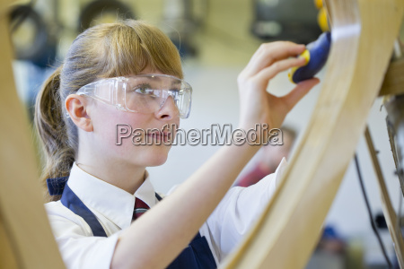female high school student in woodworking