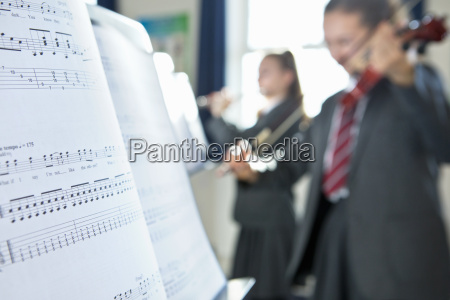 sheet music in foreground with high