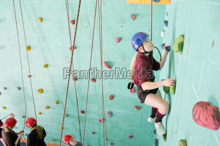 girl climbing rock climbing wall