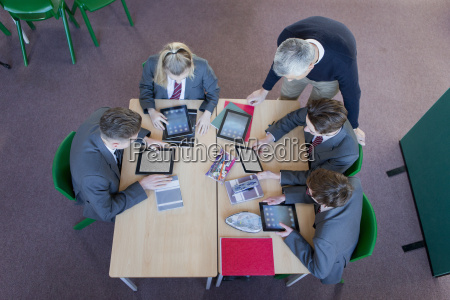 teacher and high school students using