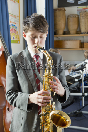 middle school student playing saxophone in