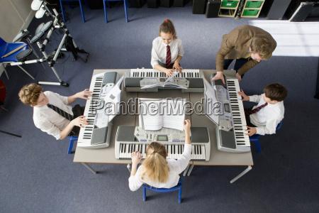 music teacher teaching middle school students