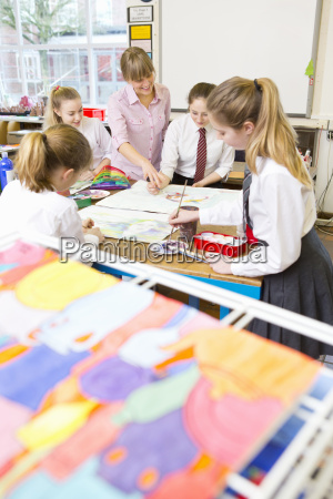 painting drying with art teacher teaching