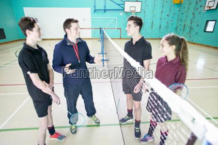 gym teacher teaching high school students