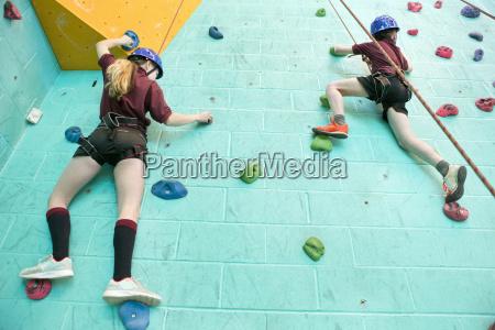 high school students climbing rock climbing