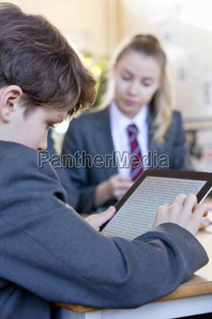 high school student using digital tablet