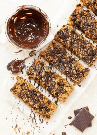 freshly baked muesli bars with chocolate