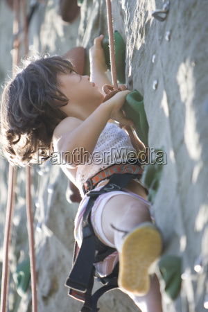 a young girl on a climbing