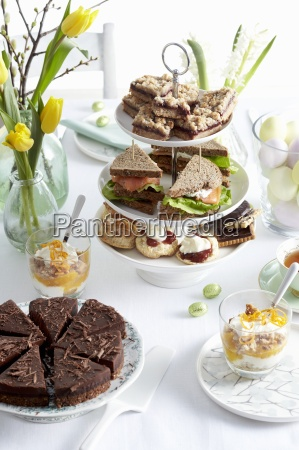an easter buffet with cake biscuits