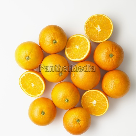 oranges whole and halved on a
