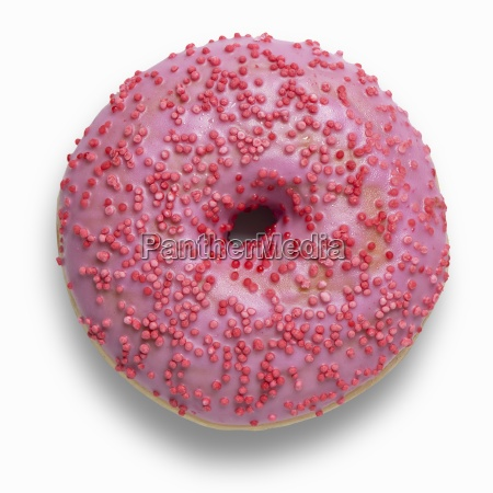 a pink doughnut decorated with red