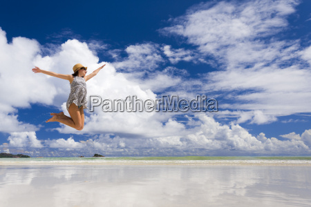 beautiful woman jumping at the beach