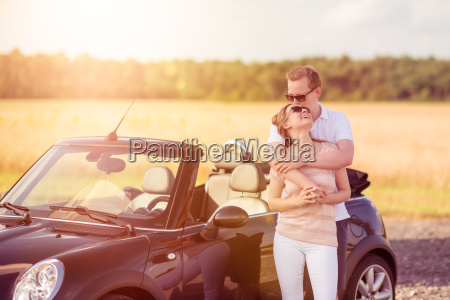 love couple embracing on the car