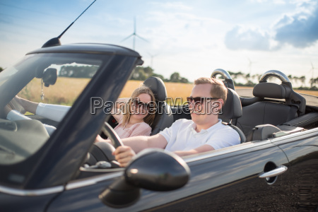 young loving couple in the convertible