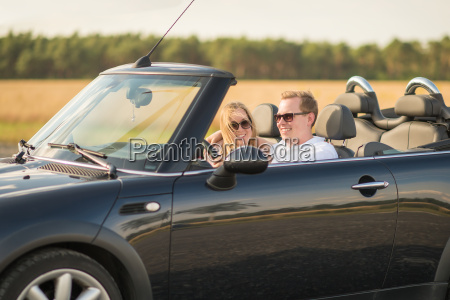 loving couple with convertible on the