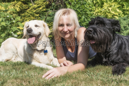 blonde woman with dogs on the