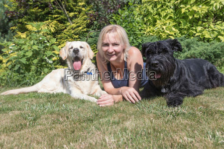 smiling woman with dogs on the