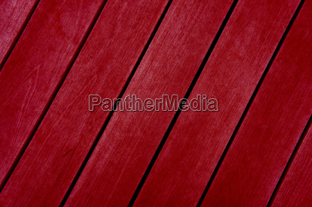 red diagonal wooden boards