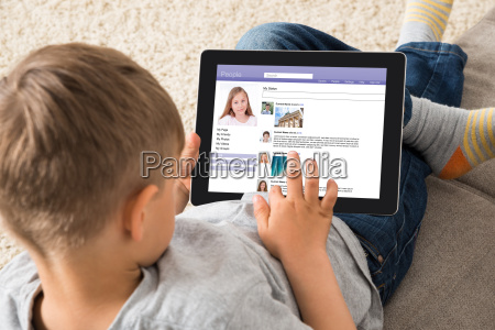 boy using social networking site on