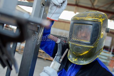 man in the factory with mask