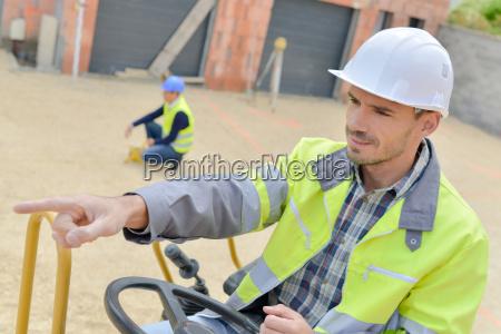 man driving a digger