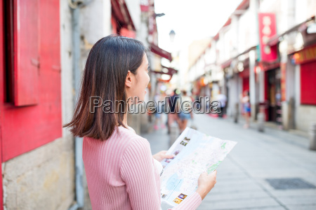 woman looking at city map in