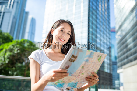 woman finding the location on city