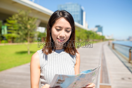 woman using map to find the