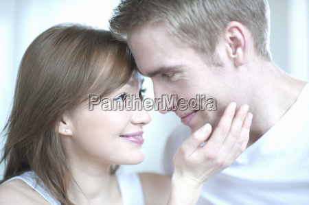 young woman touching mans face close