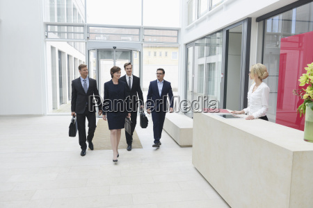 business people arriving in offices