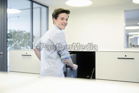 teenage boy in office portrait