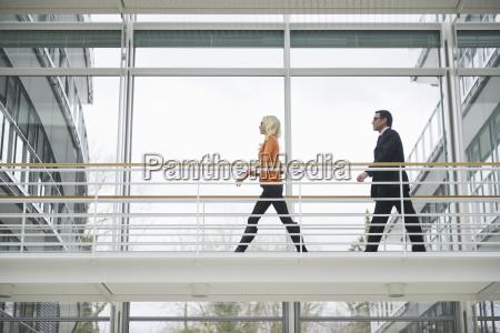 business people on office walkway