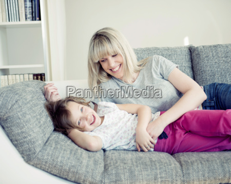 young girl and mother lying on