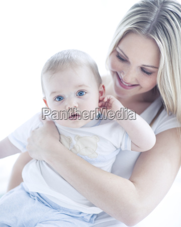 teenage girl holding baby boy