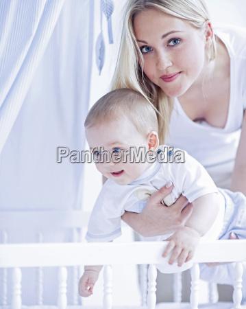 teenage girl holding baby boy