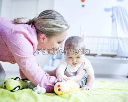 teenage girl playing with baby boy