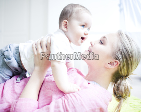 teenage girl holding baby boy close