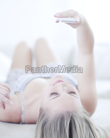 teenage girl looking at cell phone