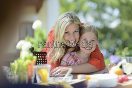 mother and girl smiling portrait