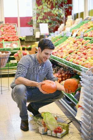 man shopping in an organic grocery
