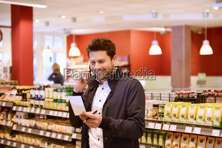 man using cell phone and shopping