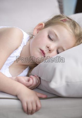girl sleeping on pillow close up