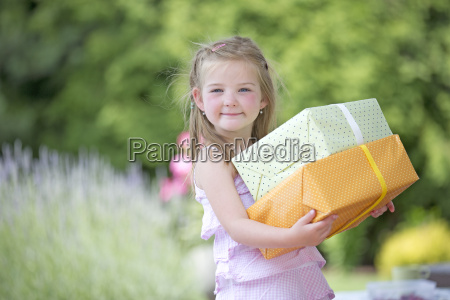 young girl holding presents portrait