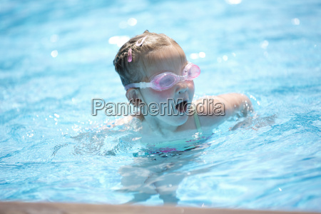 young girl in swimming goggles in