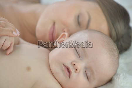 mother and baby boy sleeping